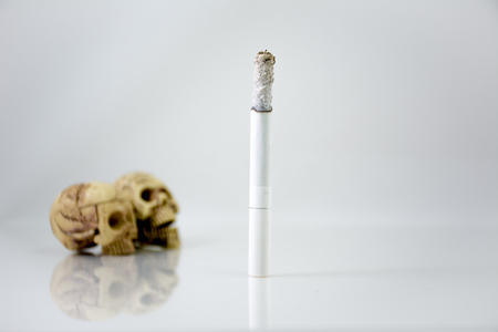 kill: Smoking can kill you. Still Life with a Skull concept, white background