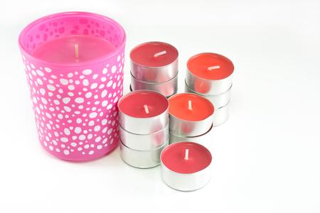 kerze: Rote und rosa Kerzen auf weißem Hintergrund Lizenzfreie Bilder