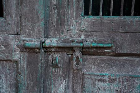 green door: Old latch on a wooden green door Stock Photo