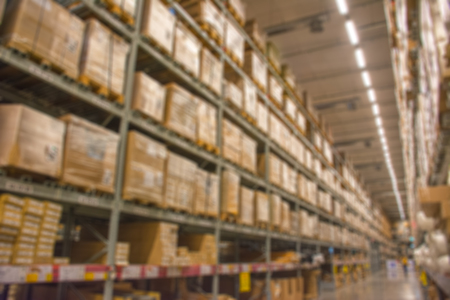 warehouse: Abstract blurred boxes on rows of shelves in big modern warehouse background