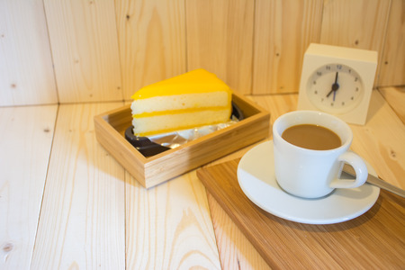 orange cake: Coffee in the morning with orange cake on wood background Stock Photo