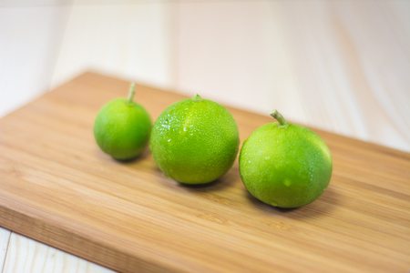 cutting boards: Three lemons on wooden cutting boards.