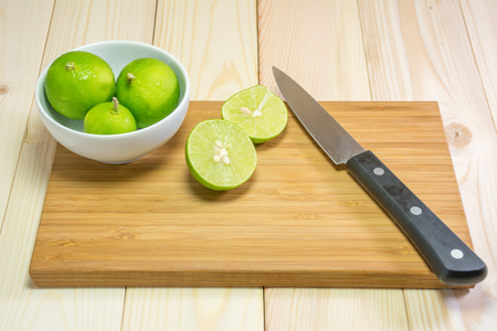 cutting boards: Lemons on wooden cutting boards with knife.
