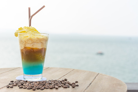 frappe: Coffee frappe with beautiful sea in background