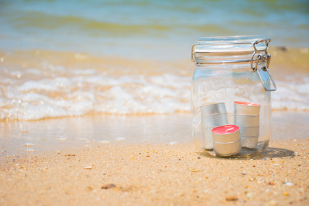 wedding decor: Candles in jar with beautiful beach and sea in background