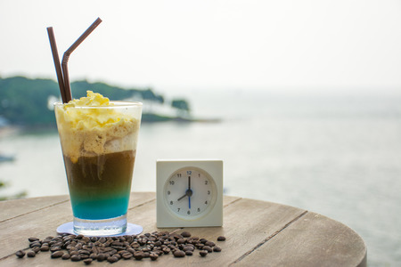 frappe: Coffee frappe in the morning with beautiful sea in background