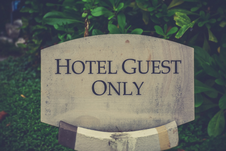 constrain: Hotel guest only sign, Thailand - vintage filter