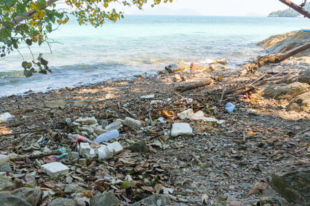 garbage on tropical beach. Imagens