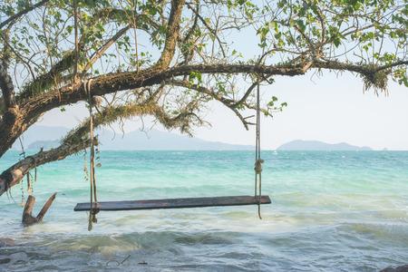 trad: Swings at tree on the sand beautiful tropical beach at koh wai island, Trat, Thailand.