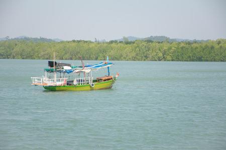 Wooden Fishing boats at the sea. Imagens