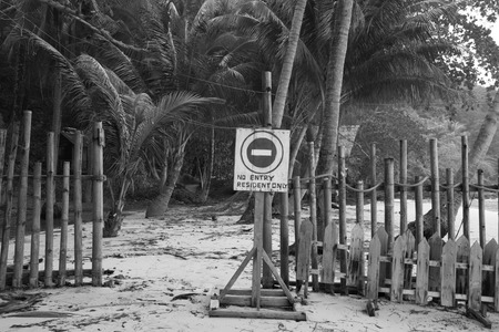 No entry resident only sign on the private beach at koh wai island, Trat, Thailand - monochrome.