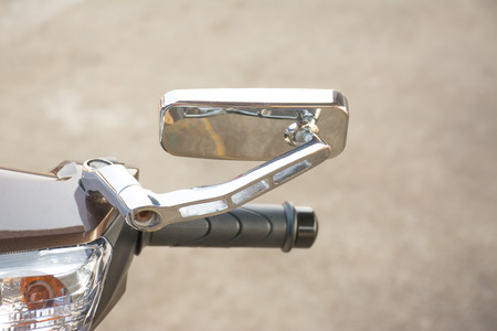 Close-up view of motorcycle handle and mirror Imagens