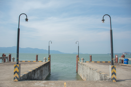 The harbor On a gloomy sky waiting for boat at Laem Ngop, Trat, Thailand.