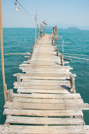 Summer, Travel, Vacation and Holiday concept - Beautiful wooden pier at a beach in Koh wai island, Trat, Thailand.