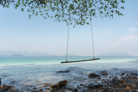 trad: Swings at tree on the sand and rock beautiful tropical beach at koh wai island, Trat, Thailand.
