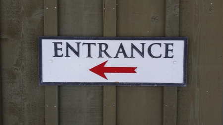Entrance Sign with Red Arrow