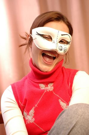 Portrait of young happy smiling woman in mask Stock Photo