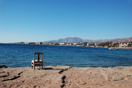 Empty chair near the sea.