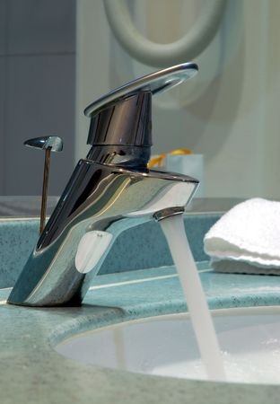 Bathroom tap with running water Stock Photo