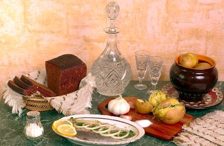 Traditional russian talbe - boiled potatos, bread, herring and vodka Stock Photo