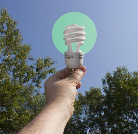 Energy saving light bulb lit outside photo