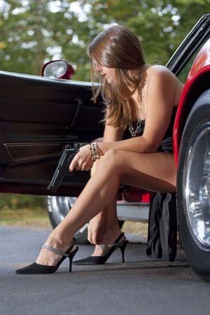 spy girl: Spy girl with gun exiting sports car