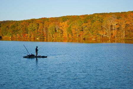 Fishrman in Risley Park Vernon Connecticut during autumn fall with beautfull October foliage Stock Photo