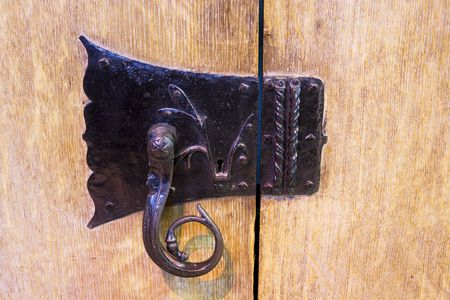 entranceway: Very old cast iron ornate cabinet catchlock
