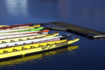 Colorful rowing boats tied together in dock Stock Photo - 2470450
