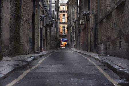 city alley: Looking down a long dark back alley