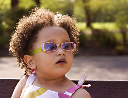 Young black  girl with glasses