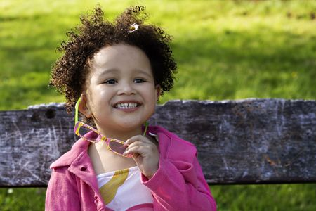 Young black  girl with glasses smiling Stock Photo