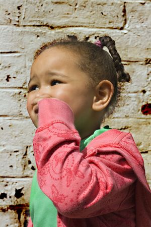 Young black  girl playing in an alley photo