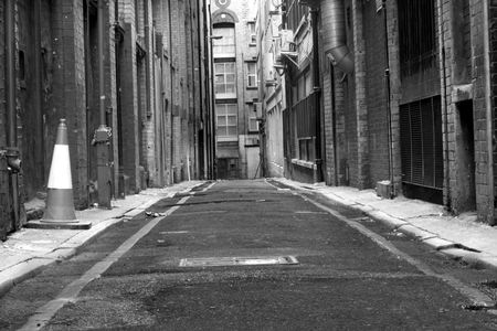 Looking down a long dark back alley photo