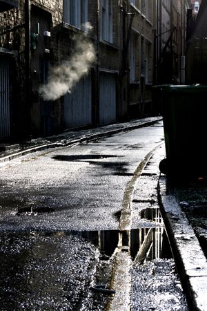 Dark alley in a rain shower photo