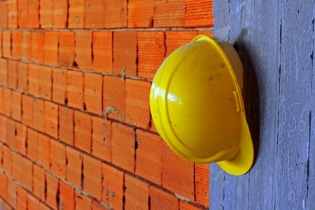 Builders yellow hard hat on a construction site Stock Photo - 9016778