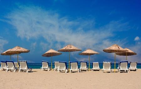 Sun loungers on a deserted beach Stock Photo - 9016686