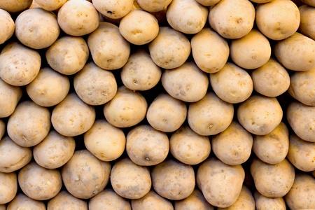 produce energy: Organic potatoes on a market stall Stock Photo
