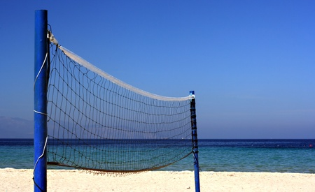 Volleyball net on an empty beach photo
