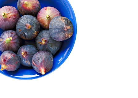 purple fig: Bowl of ripe figs isolated on white Stock Photo
