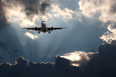 Passenger plane on final approach, against a stormy sky photo