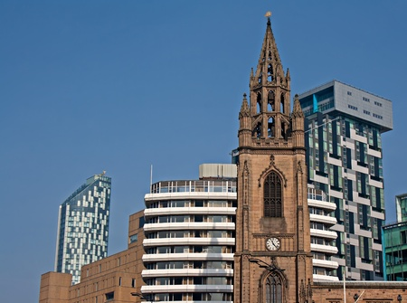 Old church amongst new high rise modern apartments