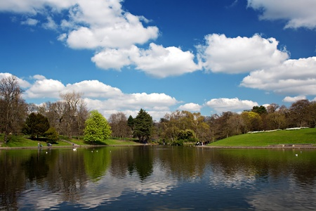 Scenic park lake in spring time, wide view Stock Photo