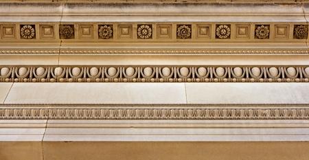 stone carvings: Intricate cornice mouldings on sandstone building