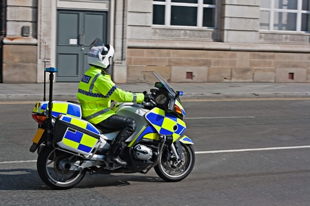 fluorescent: British motorcycle policeman