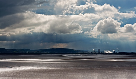 View of chemical plant across river estuary 4 photo