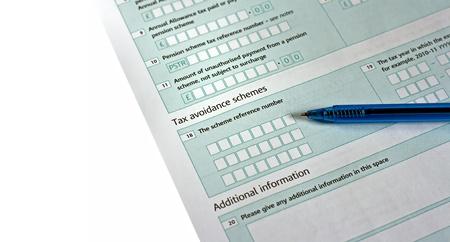 UK tax return, focus on the word Tax  photo