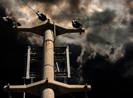electricity pylon: Electricity pylon against a dramatic stormy sky