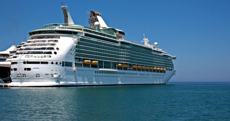 luxury liner: Large cruise ship at anchor on a clear summer day