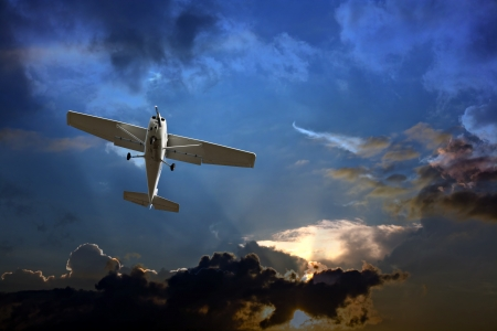fixed wing aircraft: Small fixed wing plane against a stormy sky